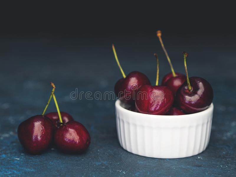 Healthy berry. Fresh group large cherries on a dark background. Closeup.  royalty free stock photos