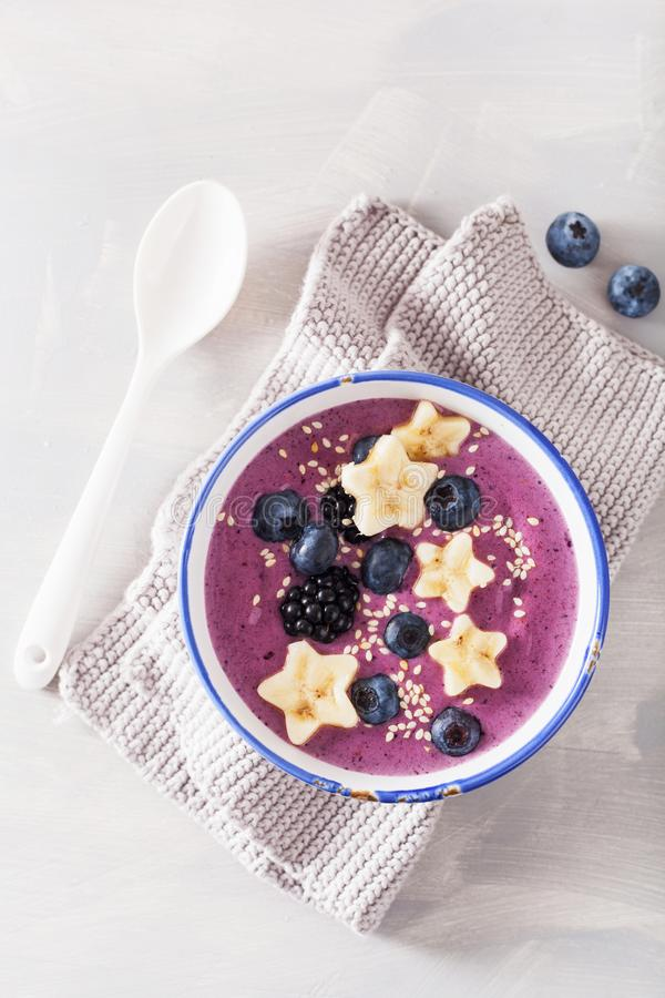 Healthy berry smoothie bowl with banana and sesame seed stock image