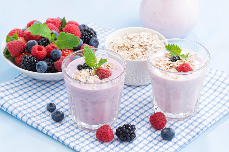Healthy berry smoothies with oatmeal in a glass, horizontal stock photos