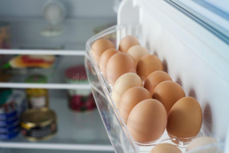 Healthy bio eggs in the fridge stock photos