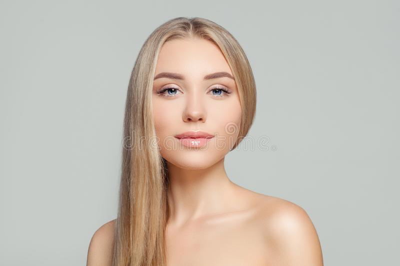 Healthy blonde woman portrait. Beauty girl with long healthy blond hair and perfect clear skin. Natural beauty.  stock photos