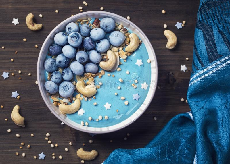 Blue spirulina smoothie bowl. Healthy blue spirulina smoothie bowl royalty free stock photos