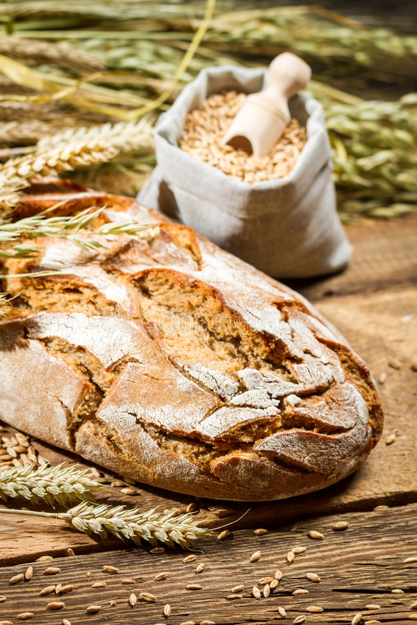 Healthy bread and a bag with grains royalty free stock photos