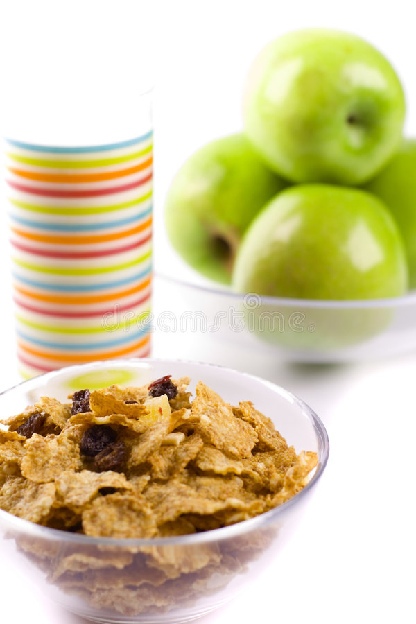 Healthy breakfast. Cornflakes, glass of milk and green apples royalty free stock photo