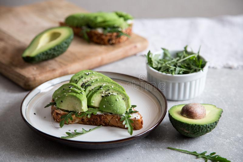 Healthy breakfast with avocado and Delicious wholewheat toast. sliced avocado on toast bread with spices. Mexican cuisine stock photo
