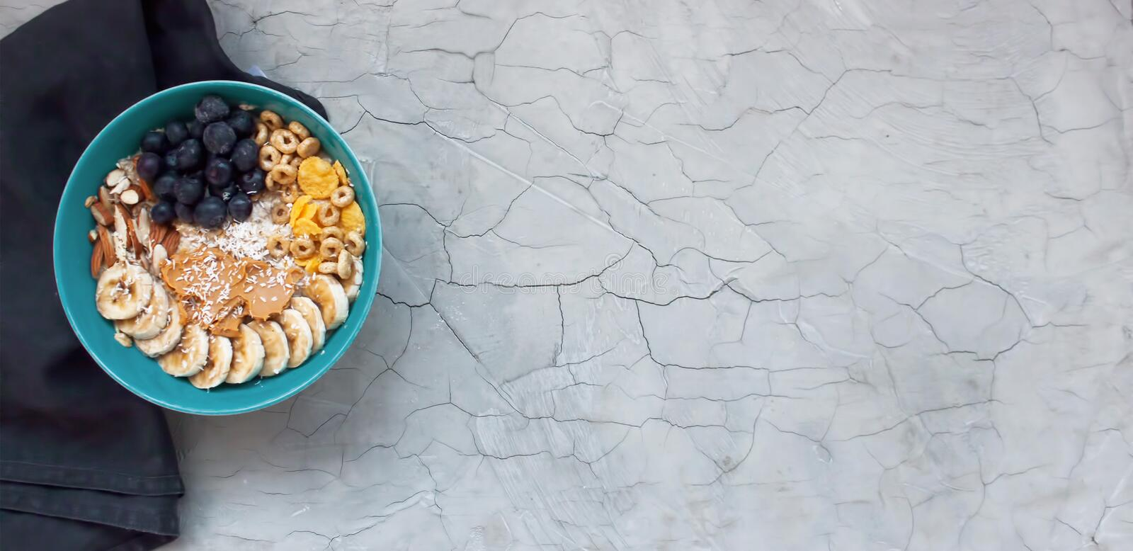 Healthy breakfast background with oats and fruits royalty free stock photo