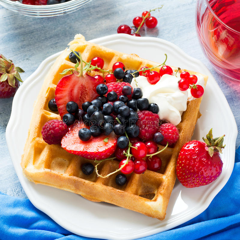 Free Healthy Breakfast: Belgian Waffles With Sour Cream, Strawberry, Raspberry, Blueberry, Cherry And Red Currant Stock Image - 94996991