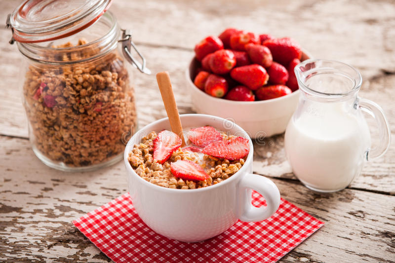Healthy breakfast. Bowl of milk with granola royalty free stock photo