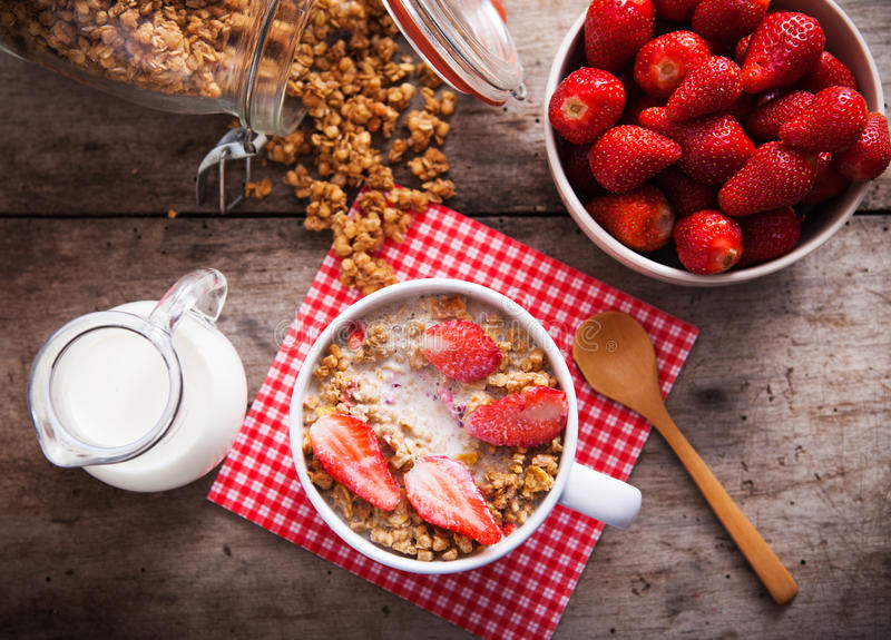 Healthy breakfast. Bowl of milk with granola stock photos
