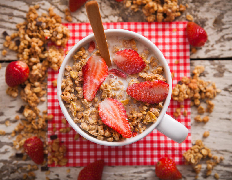 Healthy breakfast. Bowl of milk with granola stock photo