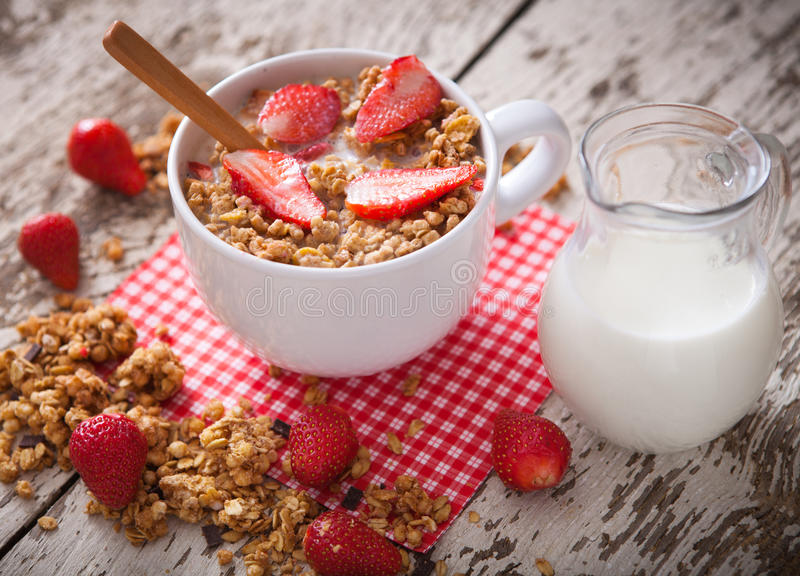 Healthy breakfast. Bowl of milk with granola. royalty free stock image