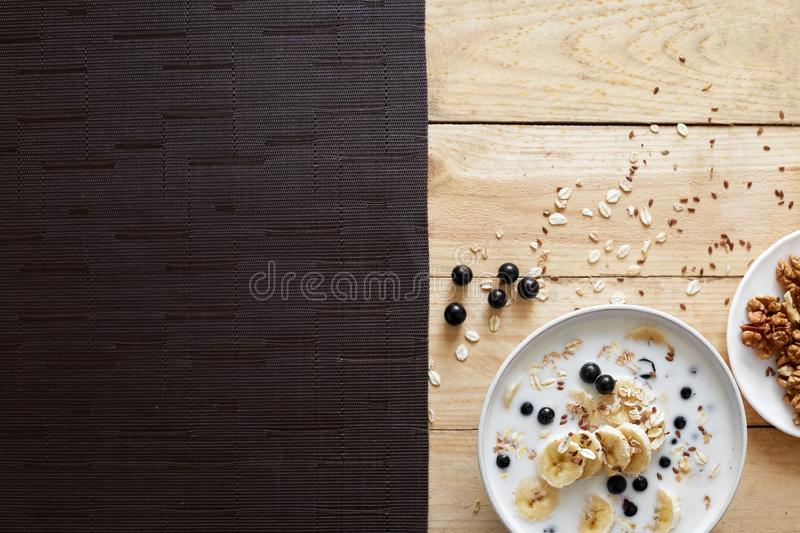 Healthy breakfast bowl: oatmeal with banana, chia seeds, cinnamon, walnuts and honey royalty free stock photos