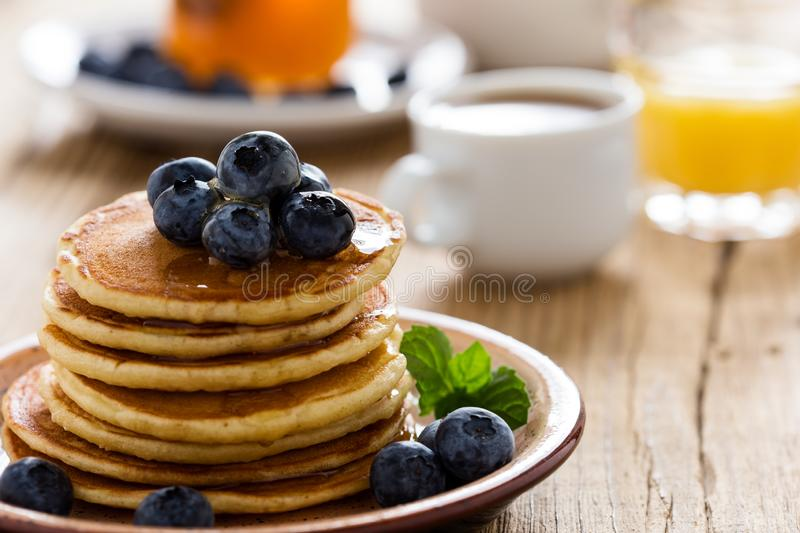 Morning meal, homemade pancakes, fresh summer berries royalty free stock photography