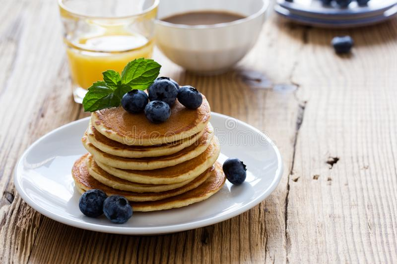 Morning meal, homemade pancakes, fresh summer berries royalty free stock photos