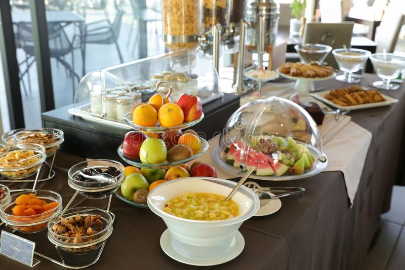 Healthy breakfast buffet table of fruit salad, various fruits, dried fruits, yoghurts during summer vacation in greek hotel. Horizontal royalty free stock photo