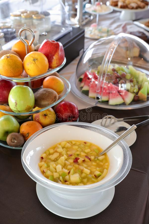 Healthy breakfast buffet table of fruit salad and various of fruits such as oranges, apples, kiwi, grapes, watermelon slices stock photos