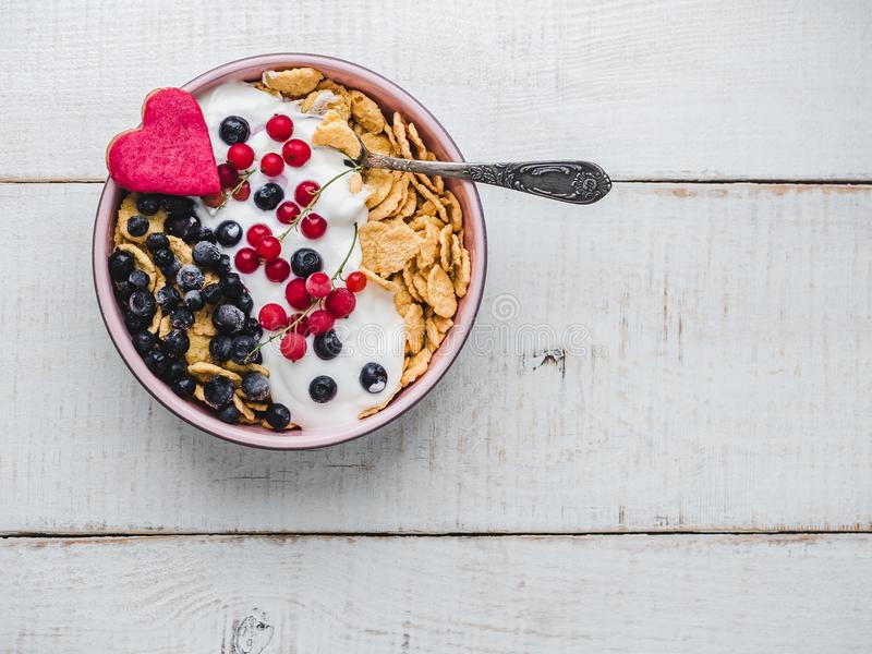 Healthy breakfast. Cereal biscuits, cornflakes, yogurt and fresh berries royalty free stock images