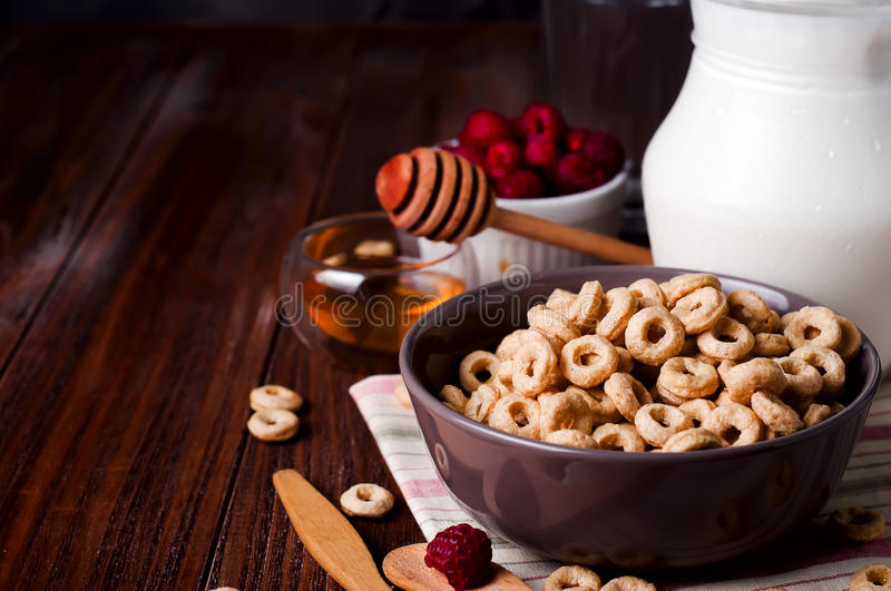 Healthy breakfast - cereal rings in a bowl with milk stock photography