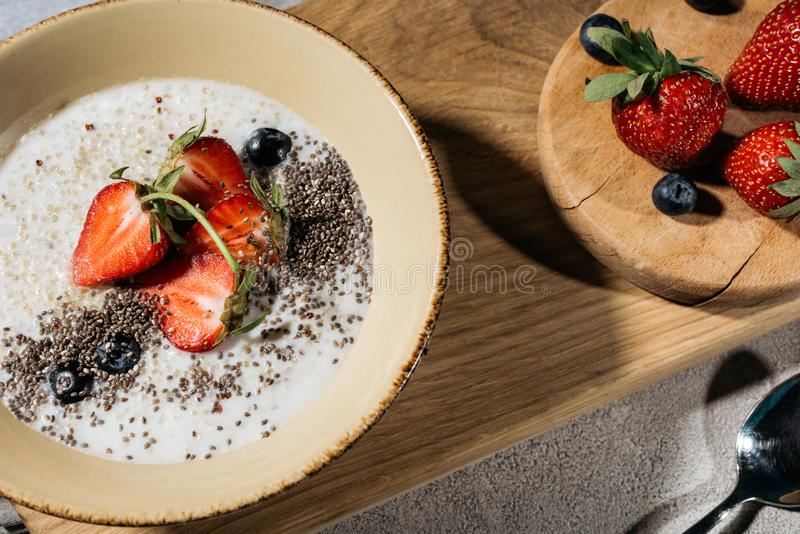Healthy breakfast with chia seeds bowl and berries. On wooden table stock image