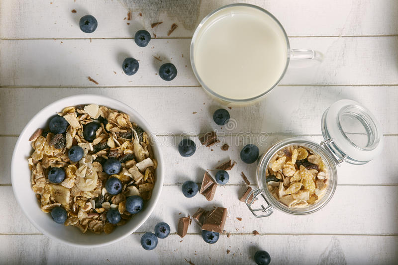 Healthy breakfast composition with milk blueberry cereals and ch stock photography