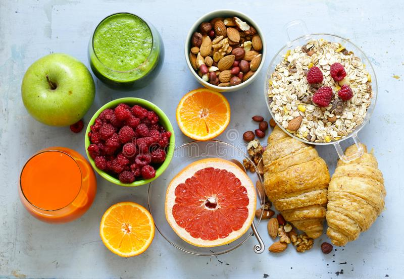 A healthy breakfast with croissants, fresh juice,. Nuts and raspberries royalty free stock photos