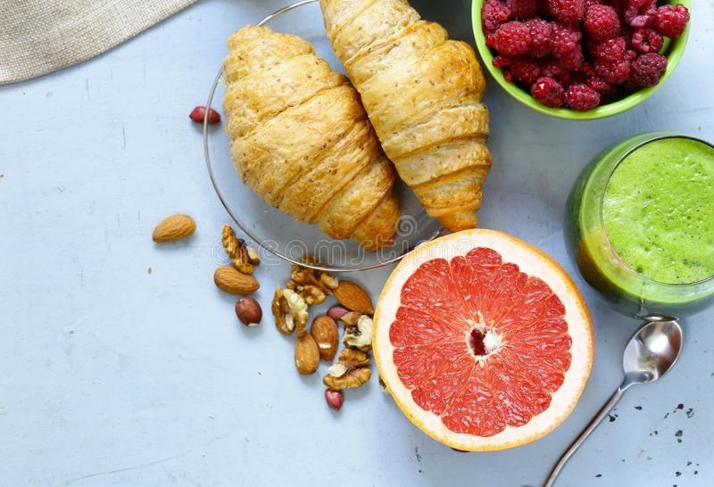 A healthy breakfast with croissants, fresh juice,. Nuts and raspberries stock images