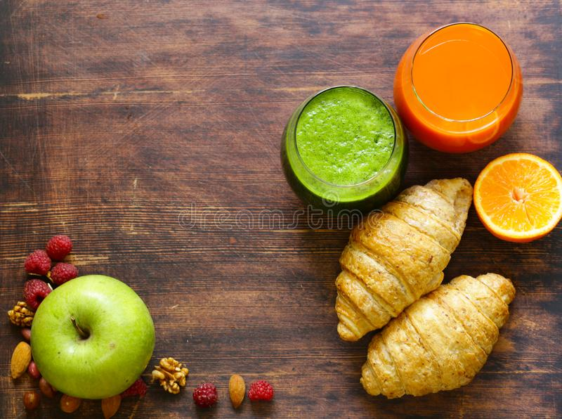 A healthy breakfast with croissants, fresh juice,. Nuts and raspberries stock photography