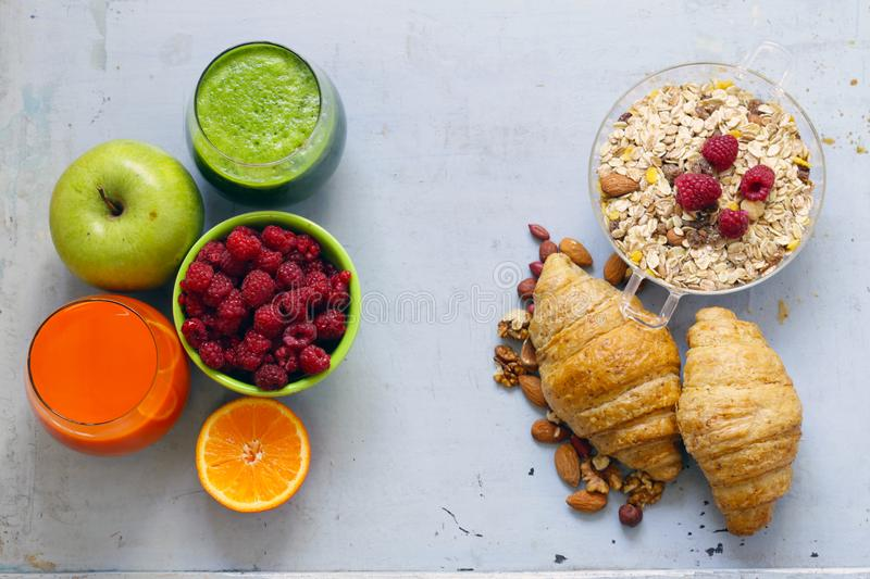 A healthy breakfast with croissants, fresh juice. Nuts and raspberries royalty free stock photos