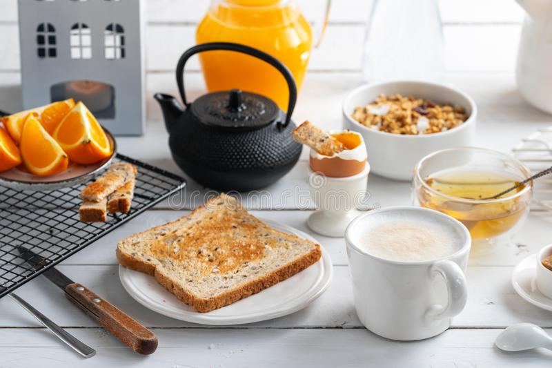 Healthy breakfast eating concept, various morning food - pancakes, soft-boiled egg, toast, oatmeal, granola, fruit stock photo