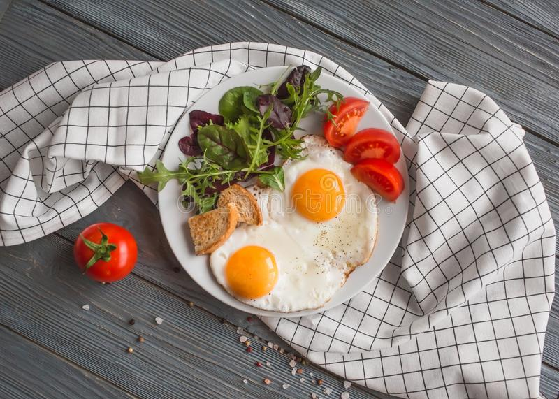 Fresh healthy breakfast eggs and salad stock images