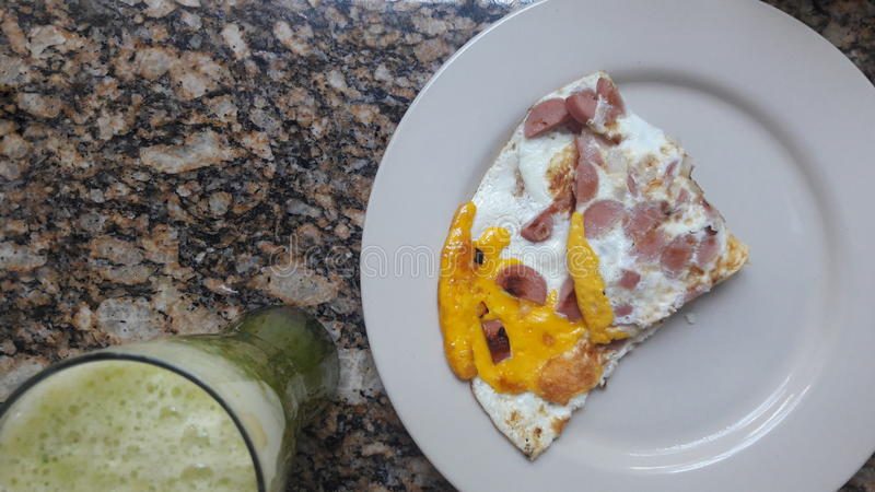 A healthy breakfast of eggs with sausage and a green juice stock photos