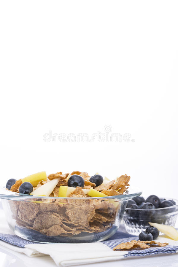 Healthy breakfast for good health. Muesli with apples and blueberries, milk carafe on a white background royalty free stock images