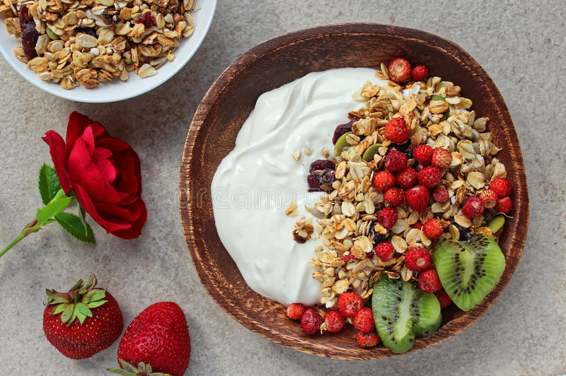 Healthy breakfast with granola and forest strawberry. Fresh organic nutrition for every age and time of day royalty free stock image