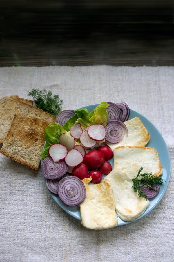 Healthy breakfast, halloumi cheese and crudities royalty free stock photo