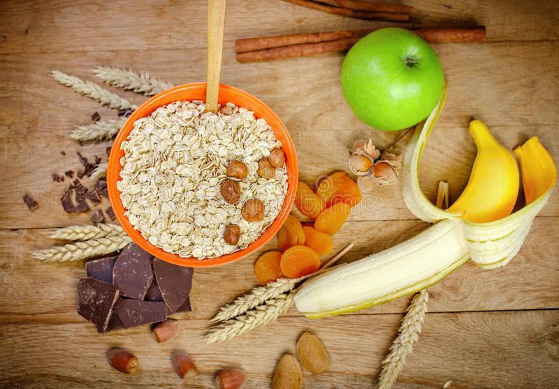 Healthy breakfast (healthy meal) - oatmeal and fruits stock photography