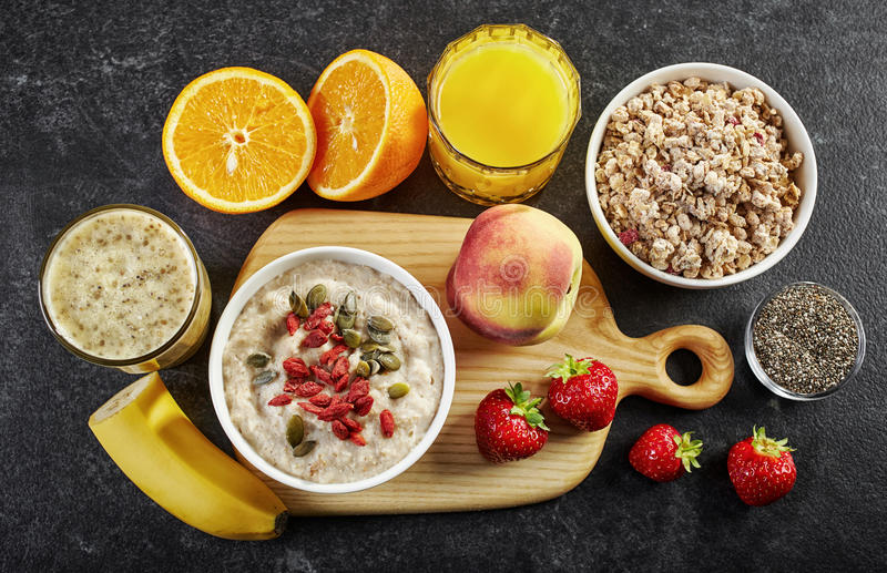Healthy breakfast ingredients. On dark background stock photo