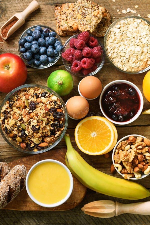 Healthy breakfast ingredients, food frame. Granola, egg, nuts, fruits, berries, toast, milk, yogurt, orange juice stock photo
