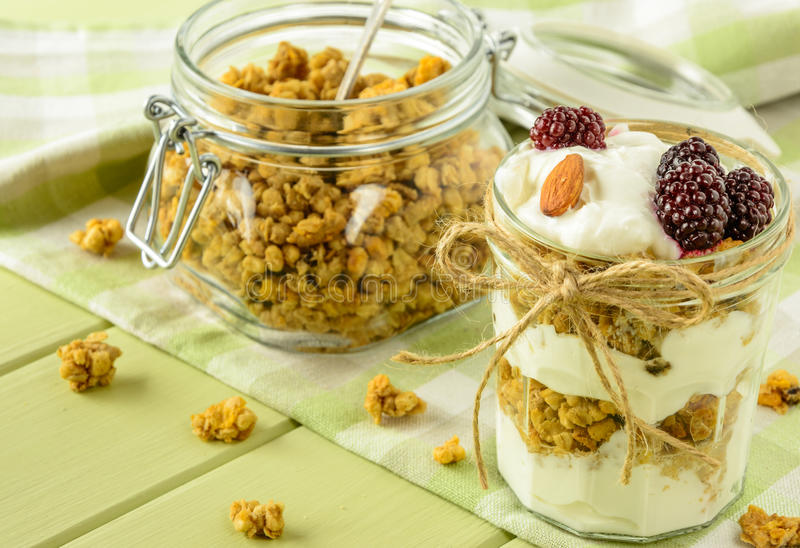 Healthy breakfast ingredients on a light green wooden table. stock photography