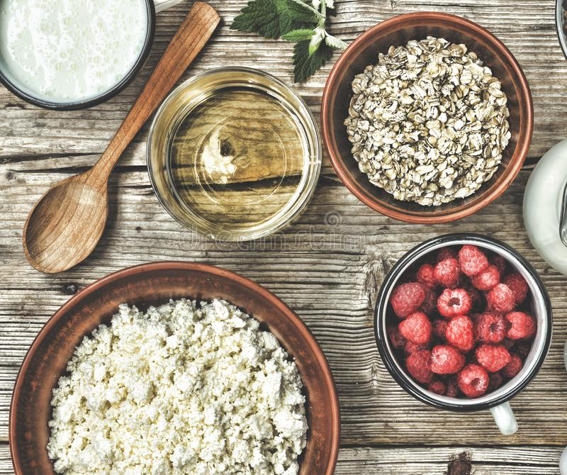 Healthy breakfast. Ingredients for muesli or granola in multi-colored bowls. Top view. stock images