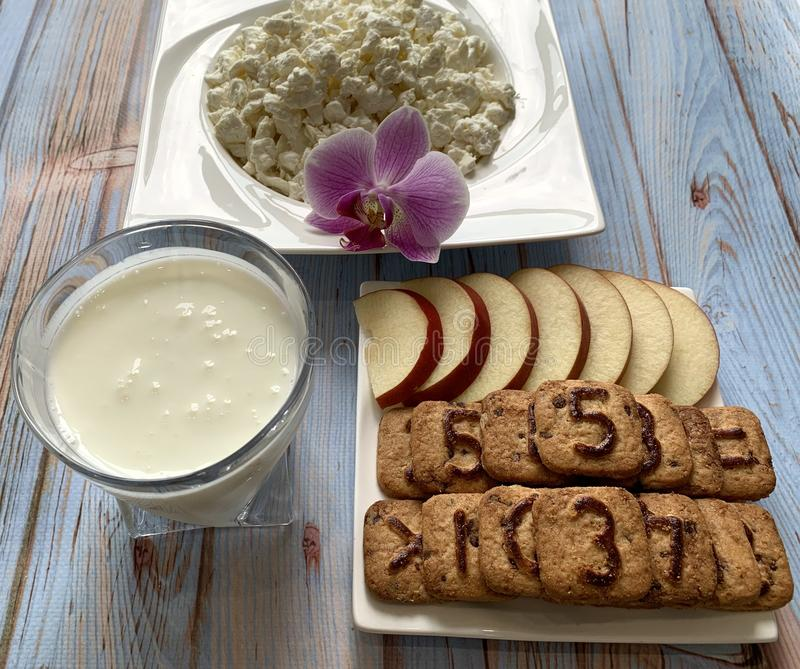 Healthy breakfast kefir and cottage cheese. Apple with cookies. stock image