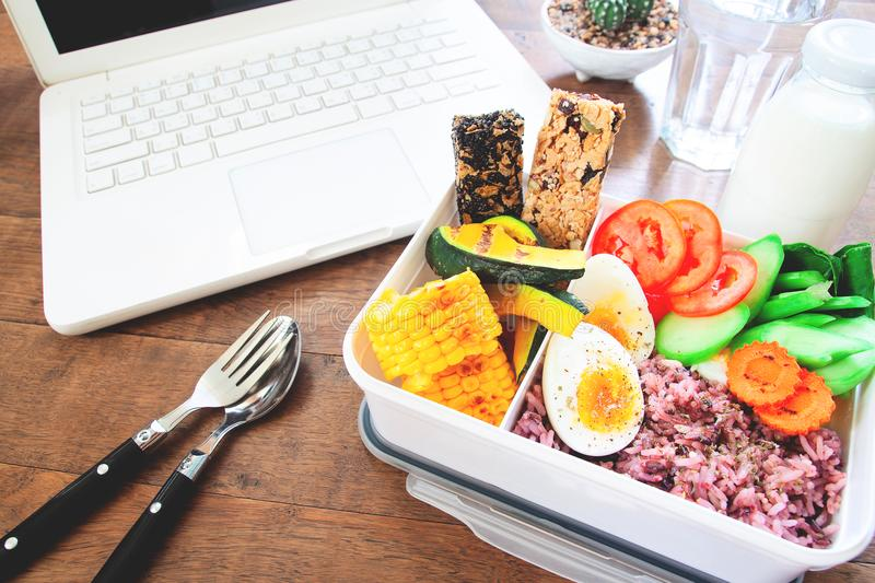 Healthy breakfast or lunch box with rice berry, boiled eggs, car royalty free stock photo