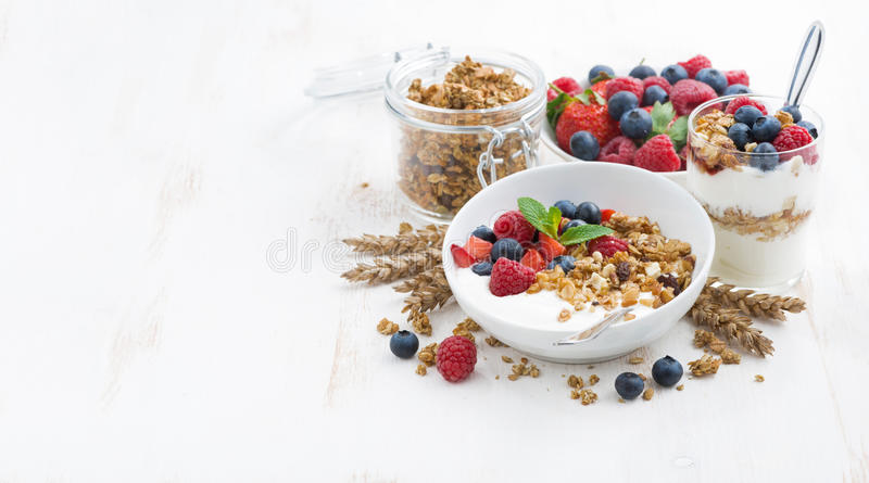 Healthy breakfast with natural yogurt, muesli and berries stock photos