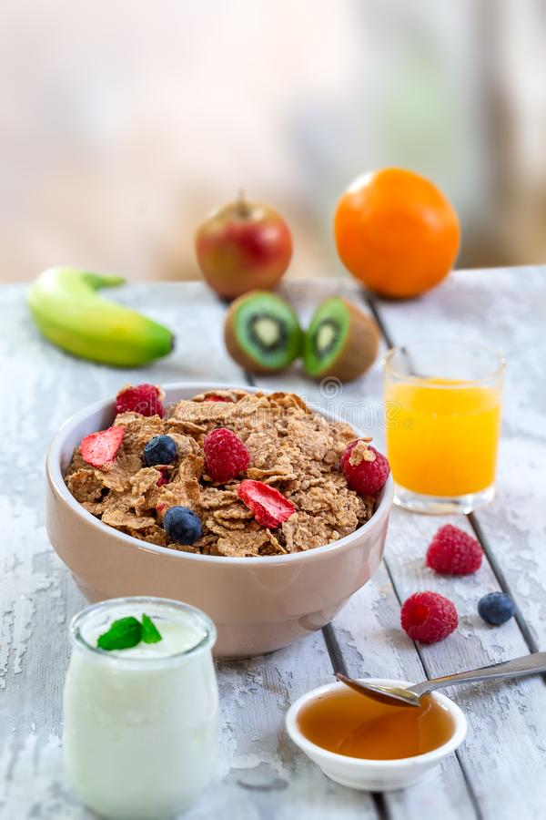 Healthy breakfast with natural yogurt, muesli and berries on wooden background royalty free stock images