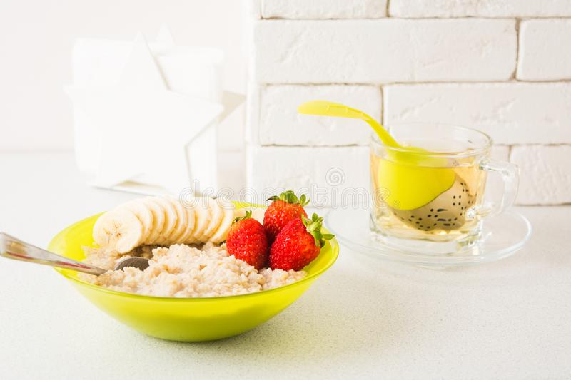 Healthy breakfast with oatmeal, banana and strawberry stock image