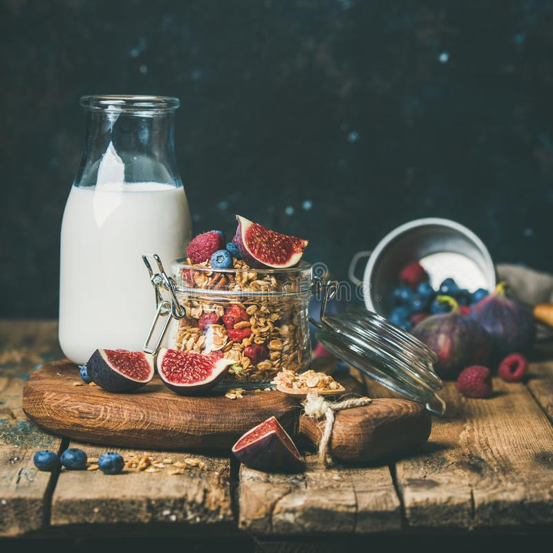 Healthy breakfast with Oatmeal granola and almond milk, square crop. Healthy vegan breakfast. Oatmeal granola with bottled almond milk, honey, fresh fruit and stock photos