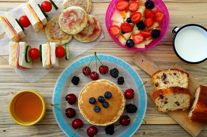 Healthy breakfast with pancake and sandwich club. Background royalty free stock images