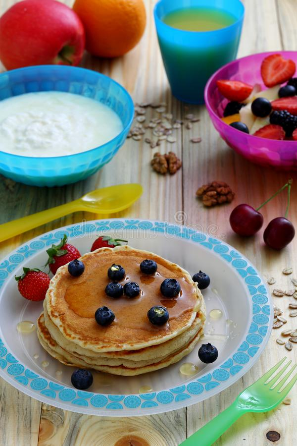 Healthy breakfast with pancake and sandwich club. Background stock image