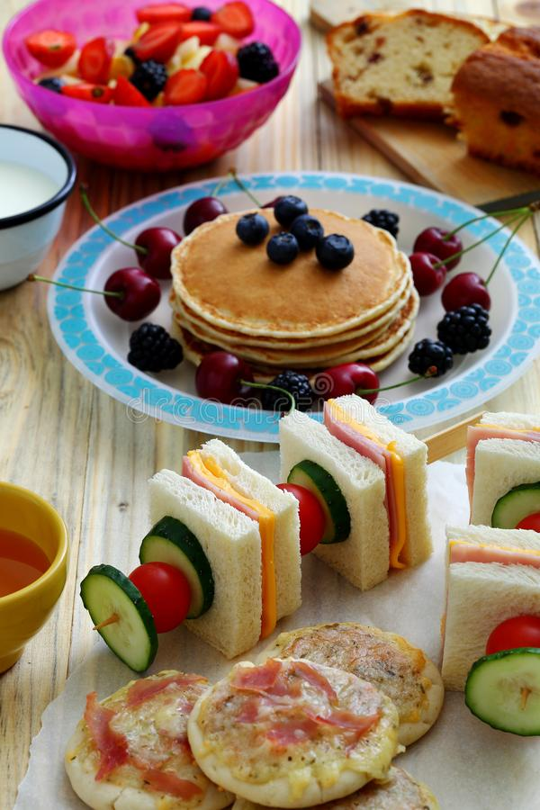 Healthy breakfast with pancake. And sandwich club vertical royalty free stock photo