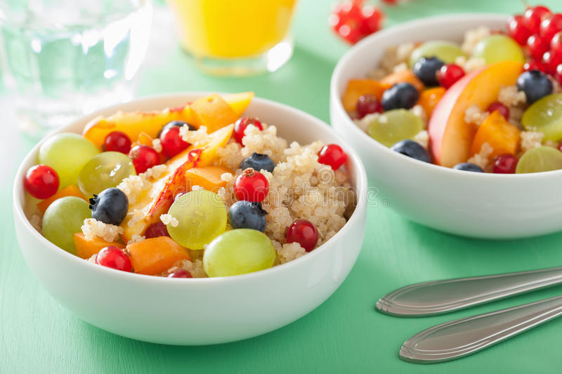Healthy breakfast quinoa with fruits berry nectarine blueberry g royalty free stock photo