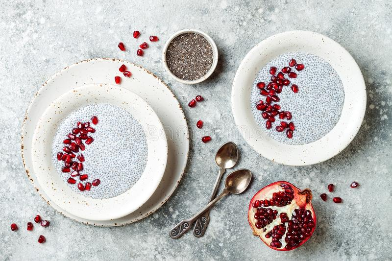 Healthy breakfast set. Chia seed pudding bowls with pomegranate.  royalty free stock images